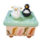 Speldosa med dansande pingviner
